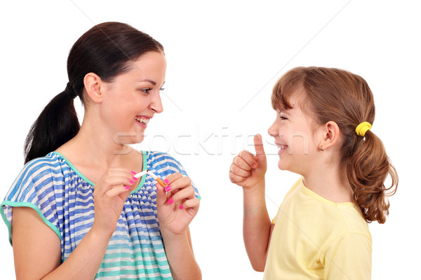 girl breaks a cigarette and a little girl with thumb up  Stock photo © goce