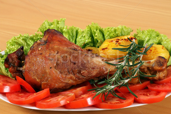 Stock photo: big turkey drumstick with potatoes and salad