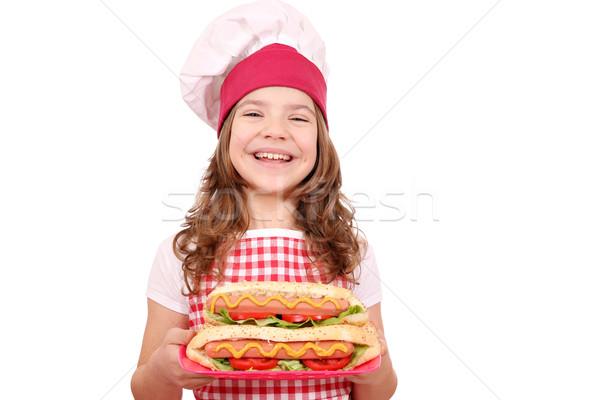 Mutlu küçük kız pişirmek sıcak köpekler kız Stok fotoğraf © goce