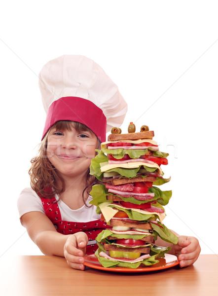 Boldog kislány szakács nagy szendvics lány Stock fotó © goce