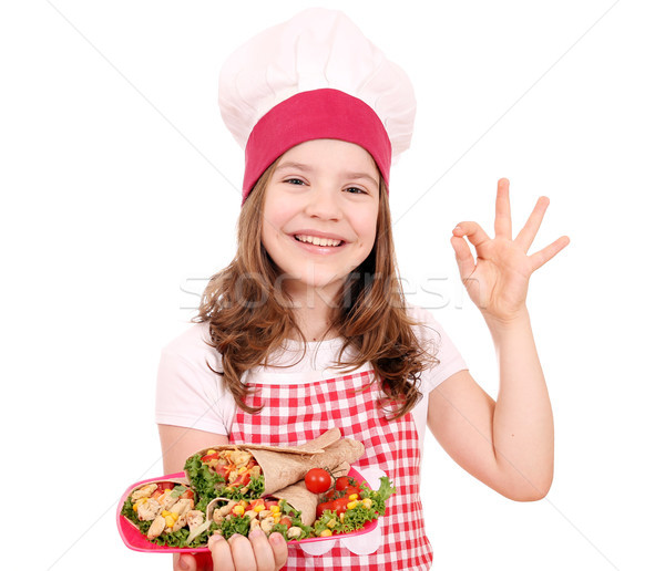Happy little girl cook with burritos and ok hand sign Stock photo © goce