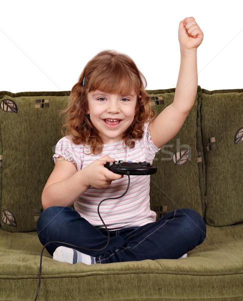 Küçük kız oynamak video oyunları el mutlu çocuk Stok fotoğraf © goce