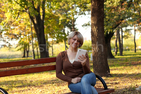 beautiful woman with tablet in park Stock photo © goce