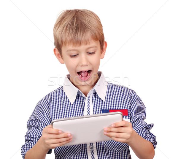 boy with tablet pc studio shot Stock photo © goce