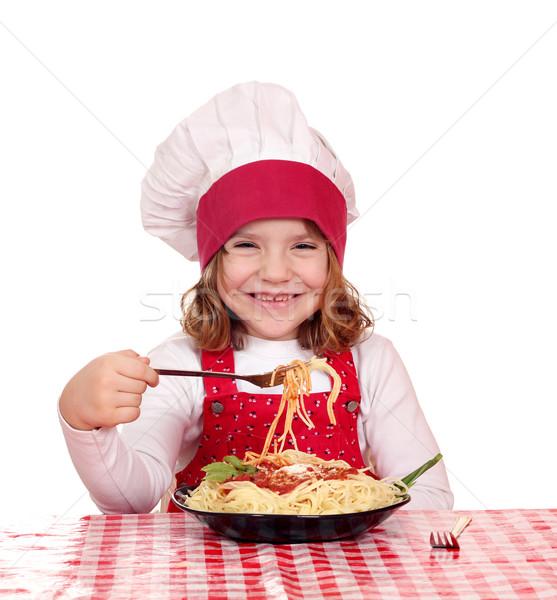hungry little girl cook eat spaghetti Stock photo © goce