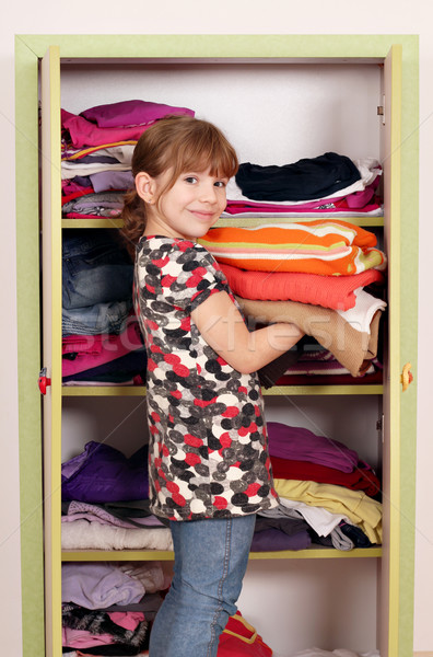 little girl girl agrees clothes in a closet  Stock photo © goce