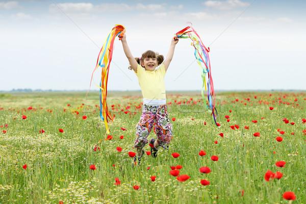 Stockfoto: Gelukkig · meisje · springen · weide · hemel · bloemen
