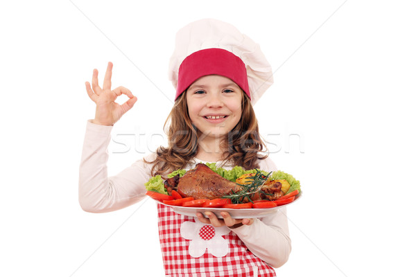 happy little girl cook with turkey drumstick and ok hand sign Stock photo © goce