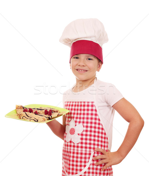 happy little girl cook with sweet crepes on plate Stock photo © goce