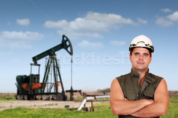 oil worker posing on oil field Stock photo © goce