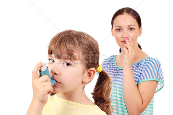 little girl with inhaler and girl smoking cigarette  Stock photo © goce
