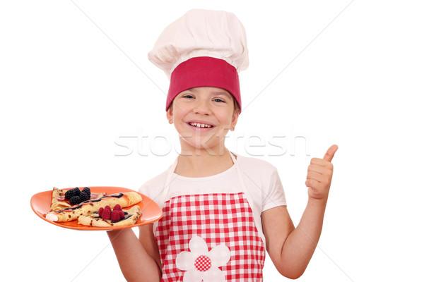 Feliz little girl cozinhar polegar para cima comida Foto stock © goce