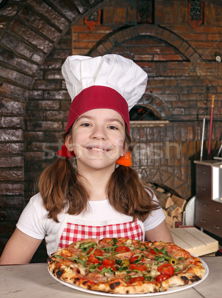 happy little girl cook with pizza in pizzeria Stock photo © goce