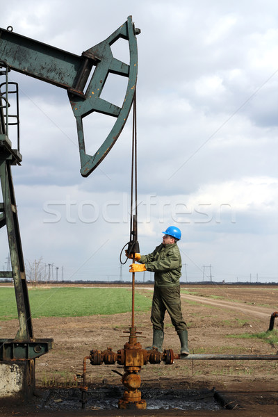 oil worker standing at pipeline Stock photo © goce