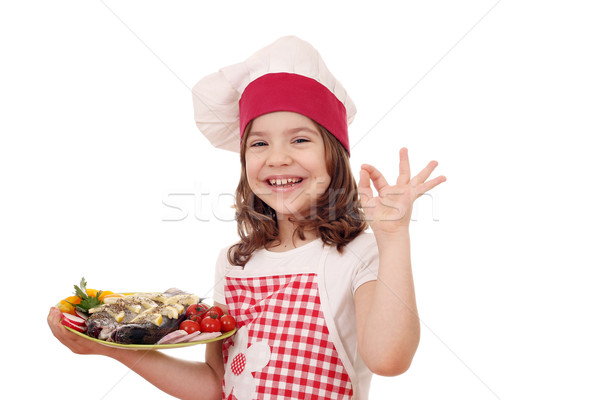 Heureux petite fille Cook truite poissons Photo stock © goce