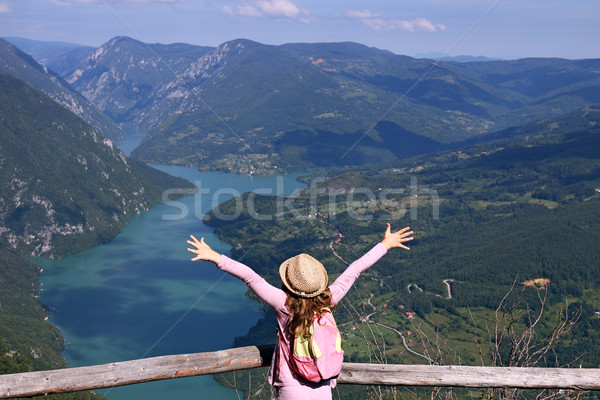 little girl hiker with hands up on mountain viewpoint Stock photo © goce