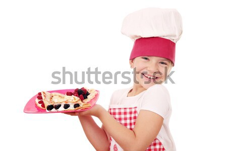 happy little girl cook with crepes on plate Stock photo © goce