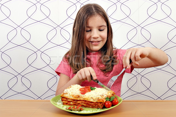 hungry little girl eating delicious lasagne Stock photo © goce