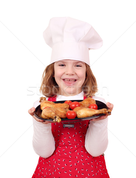 happy little girl cook hold dish with chicken drumstick Stock photo © goce
