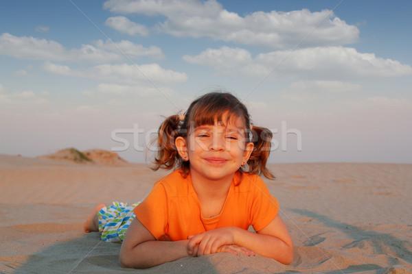 happy little girl lying on beach Stock photo © goce