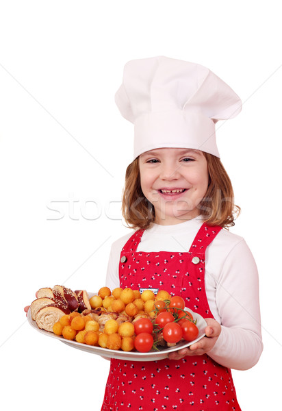 happy little girl cook hold plate with gourmet food Stock photo © goce