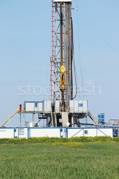 offshore oil drilling rig on green field Stock photo © goce