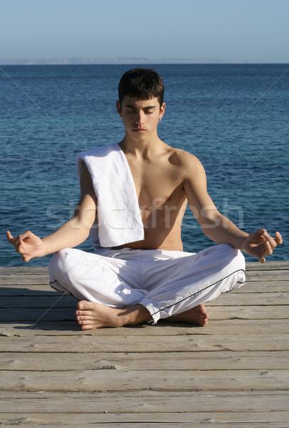 meditation or yoga, man meditating outdoors Stock photo © godfer