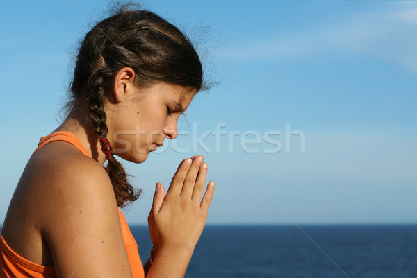 Stock photo: child praying outdoors