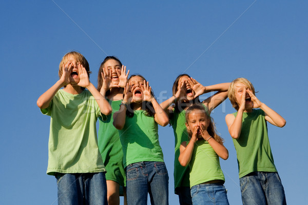 happy group of school kids shouting, cheering or singing Stock photo © godfer
