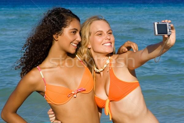 teens with camera taking photo on vacation Stock photo © godfer