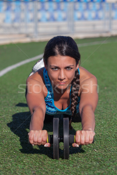 fit healthy woman exercising outdoors Stock photo © godfer
