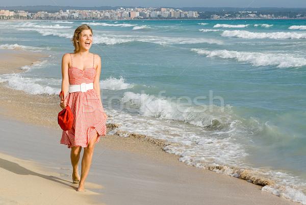 happy smiling, woman walking on summer beach Stock photo © godfer