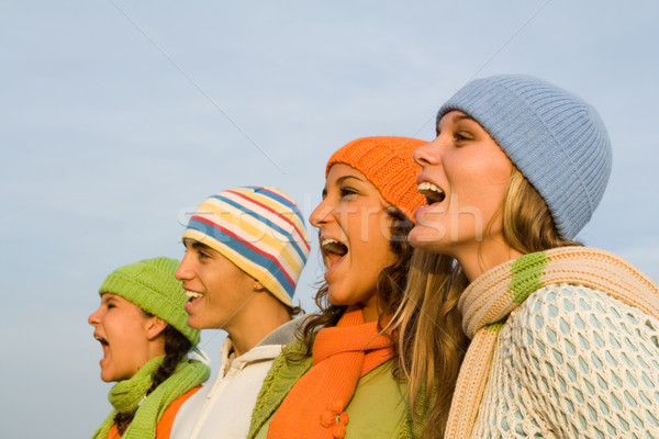 group of carolers or carol singers singing or sports spectators cheering Stock photo © godfer