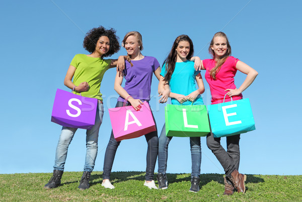 group of girls shopping in sales with bags Stock photo © godfer