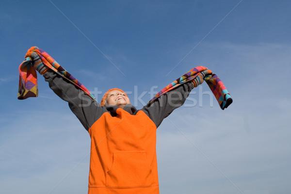 Boldog gyermek karok a magasban felfelé néz hit gyerekek Stock fotó © godfer