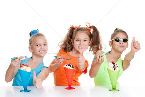Boldog gyerekek remek eszik fagylalt desszertek Stock fotó © godfer