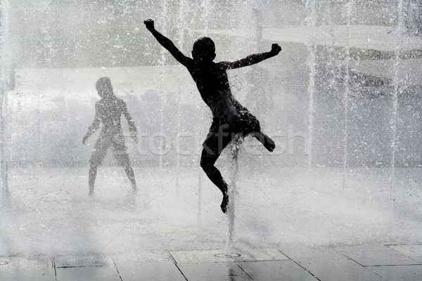 happy wet summer kids playing in water fountain Stock photo © godfer