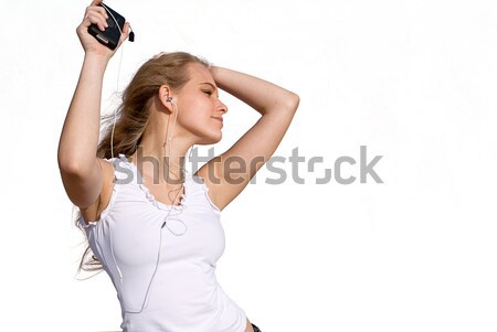 young woman or teen dancing to music from personal stereo Stock photo © godfer