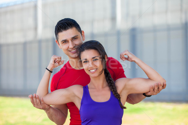 fit athletic woman with personal trainer  Stock photo © godfer