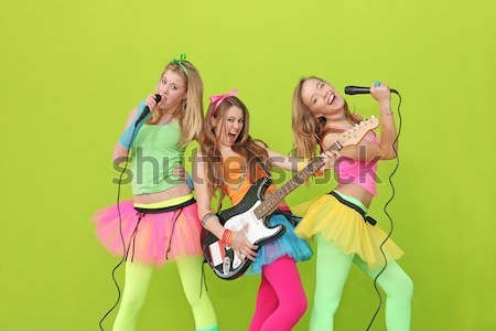 girl band, group of girls singing and playing guitar Stock photo © godfer