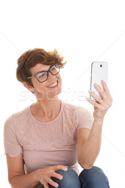 woman taking photo with camera phone Stock photo © godfer
