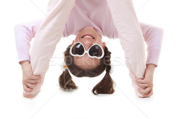 De cabeça para baixo criança diversão sorridente jogar menina Foto stock © godfer