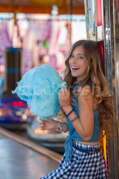 teen at fair eating candy floss or cotton. Stock photo © godfer