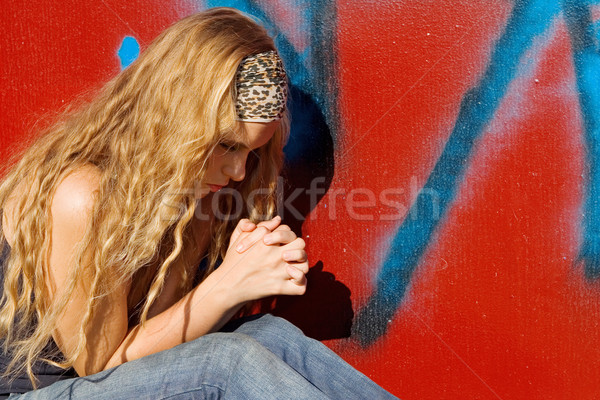 christian girl or teen saying prayers, hands clasped praying Stock photo © godfer