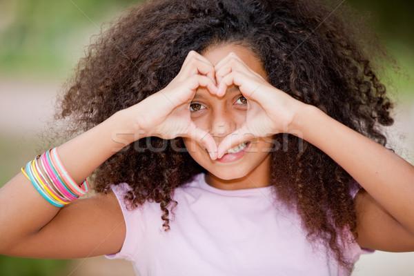Jeunes noir fille heureux souriant Photo stock © godfer
