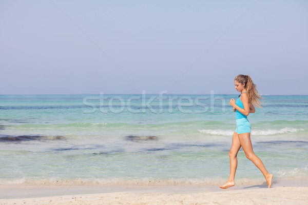 fit healthy woman jogging or running on seashore Stock photo © godfer