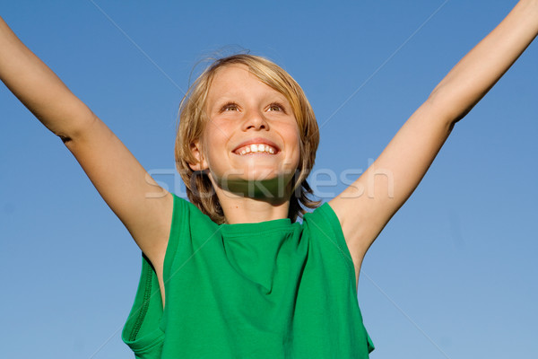 happy smiling kid child boy with arms raised in happiness Stock photo © godfer