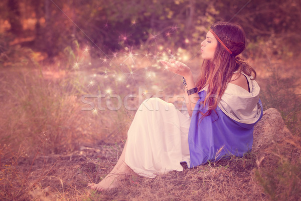woman blowing wishes in forest. fairy or elf Stock photo © godfer