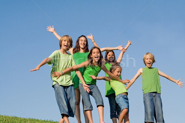 happy group of kids at summer camp singing or shouting,  Stock photo © godfer
