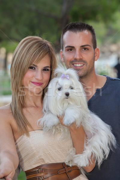 young couple with pet maltese dog Stock photo © godfer